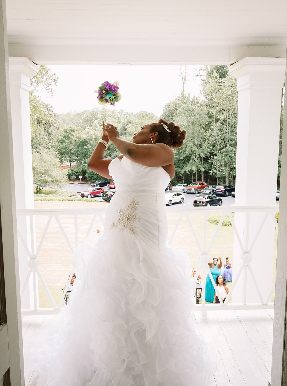 Bouquet toss off balcony