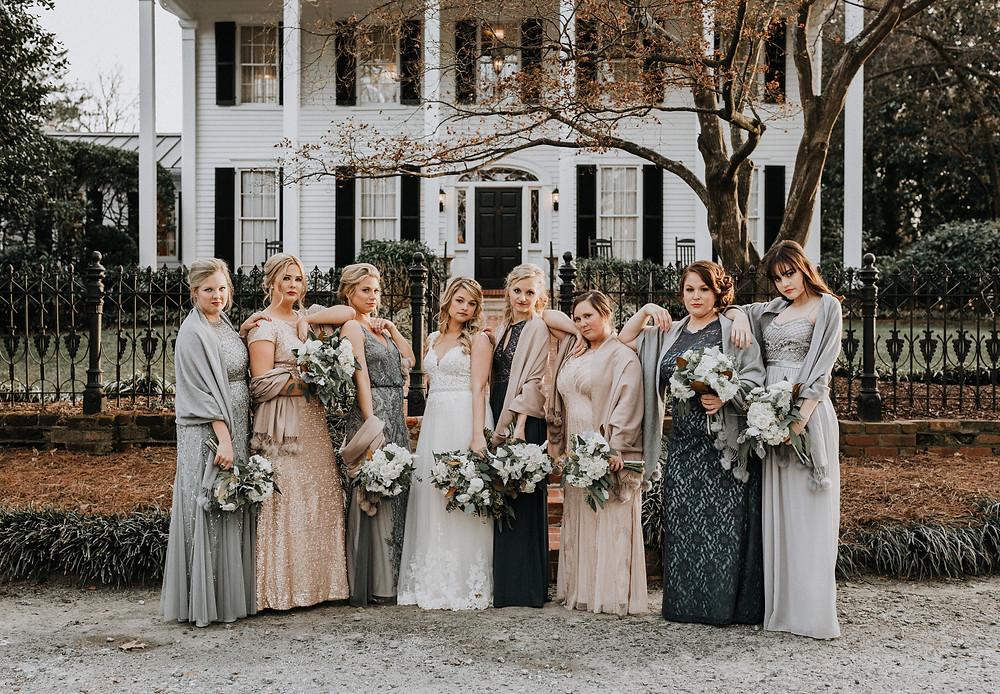 The bridesmaids pose