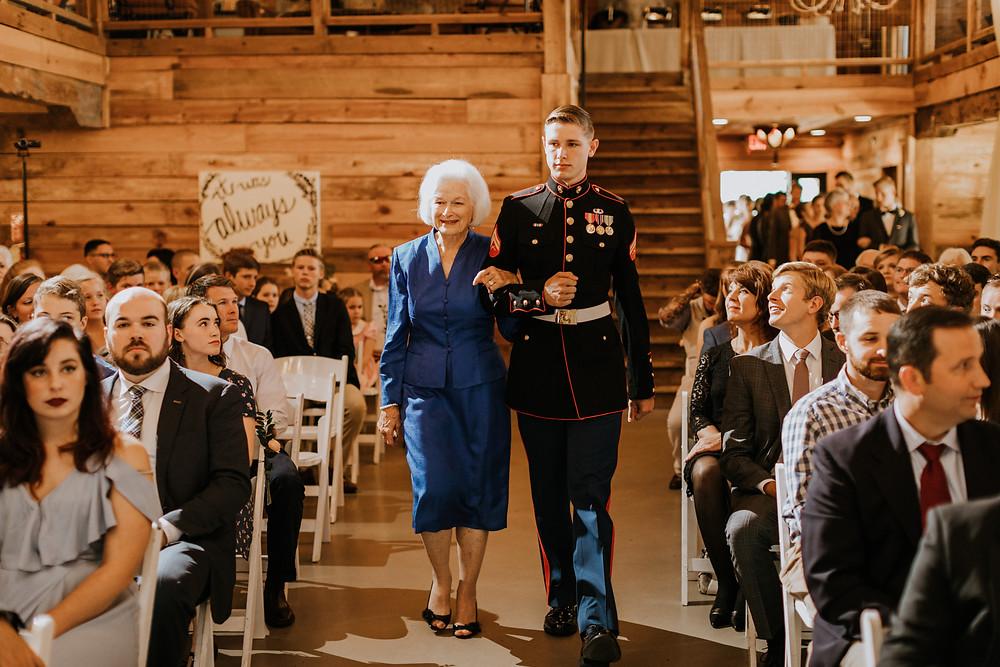 groom walks down aisle