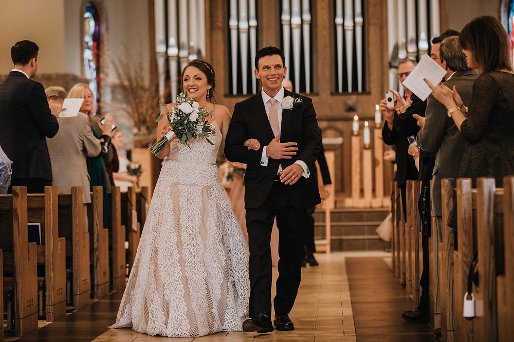 Bride And Groom Walk Down Aisle
