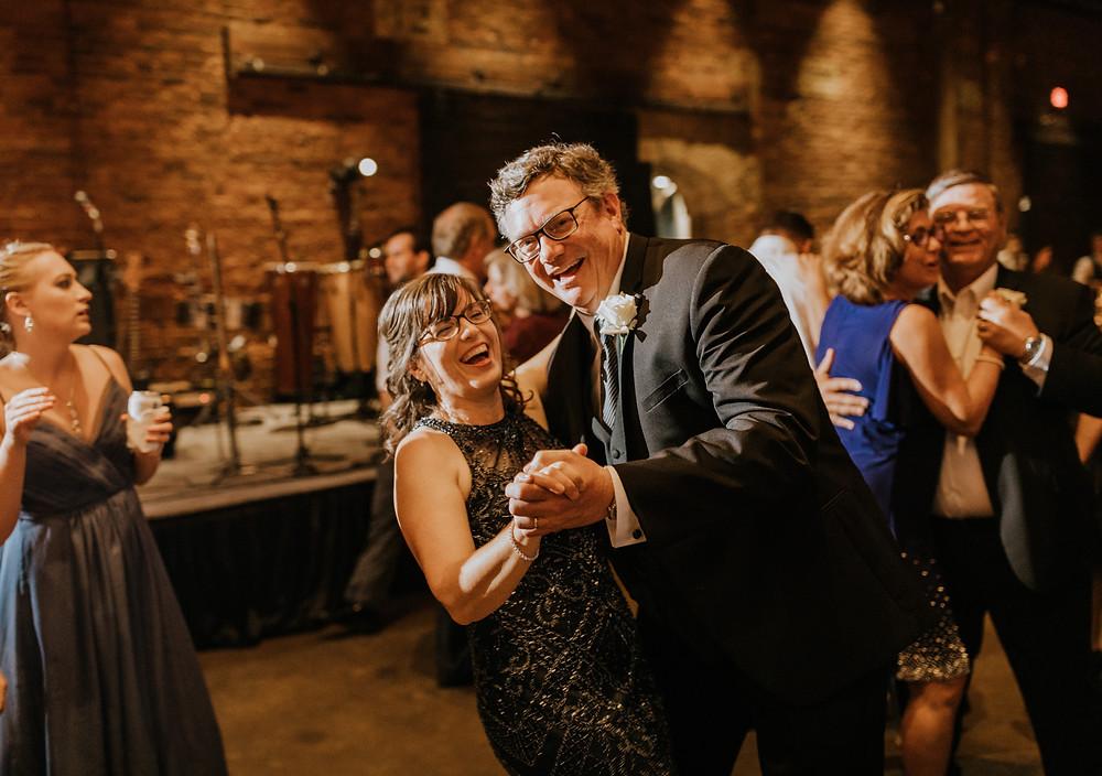 parents of groom dancing