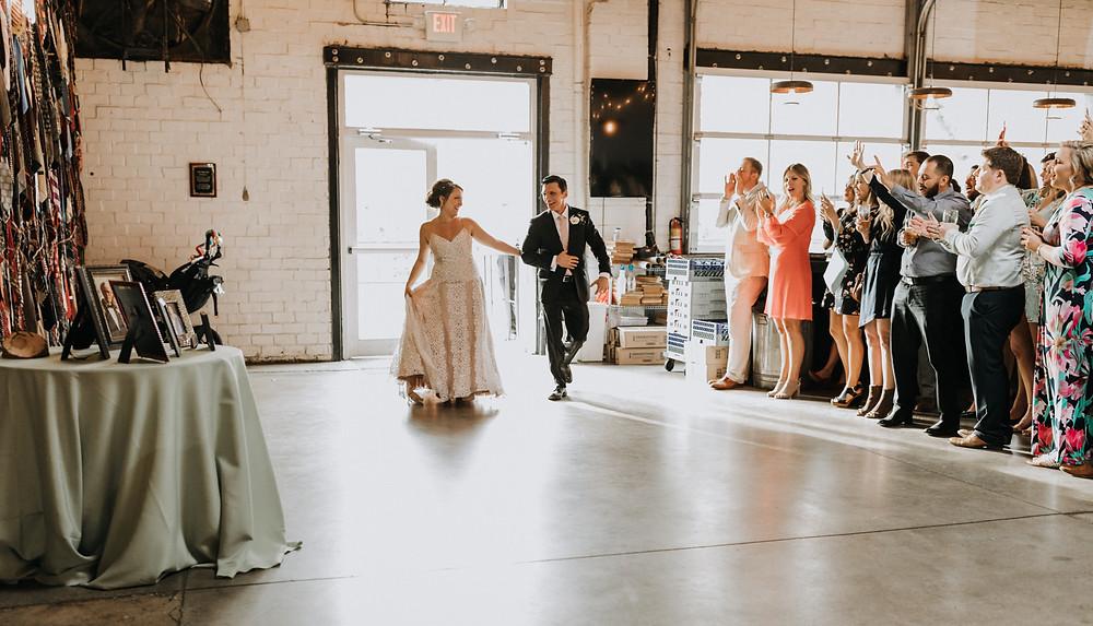 Bride And Groom Enter Reception