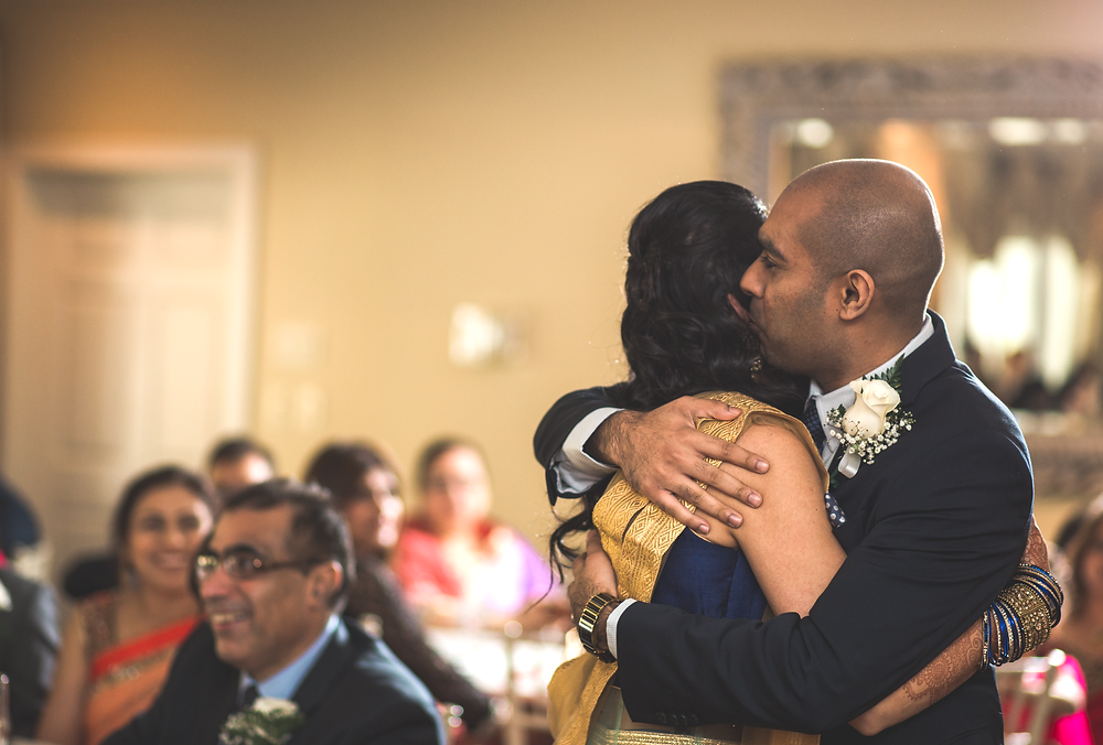 Brother hugs bride after wedding speech