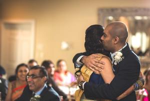Brother hugs bride after wedding speech
