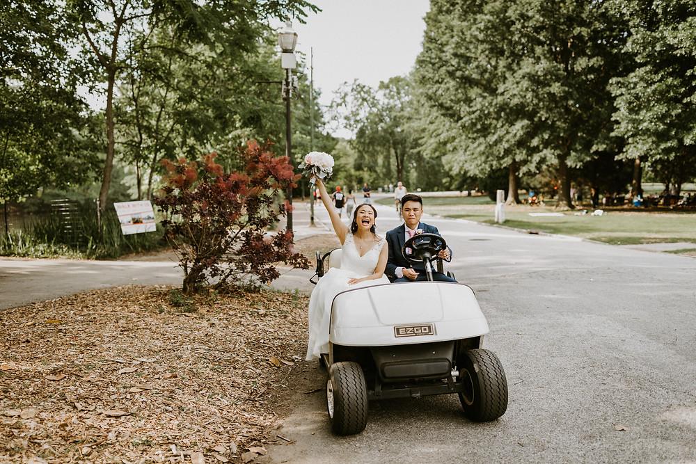 bride & groom on golf cart