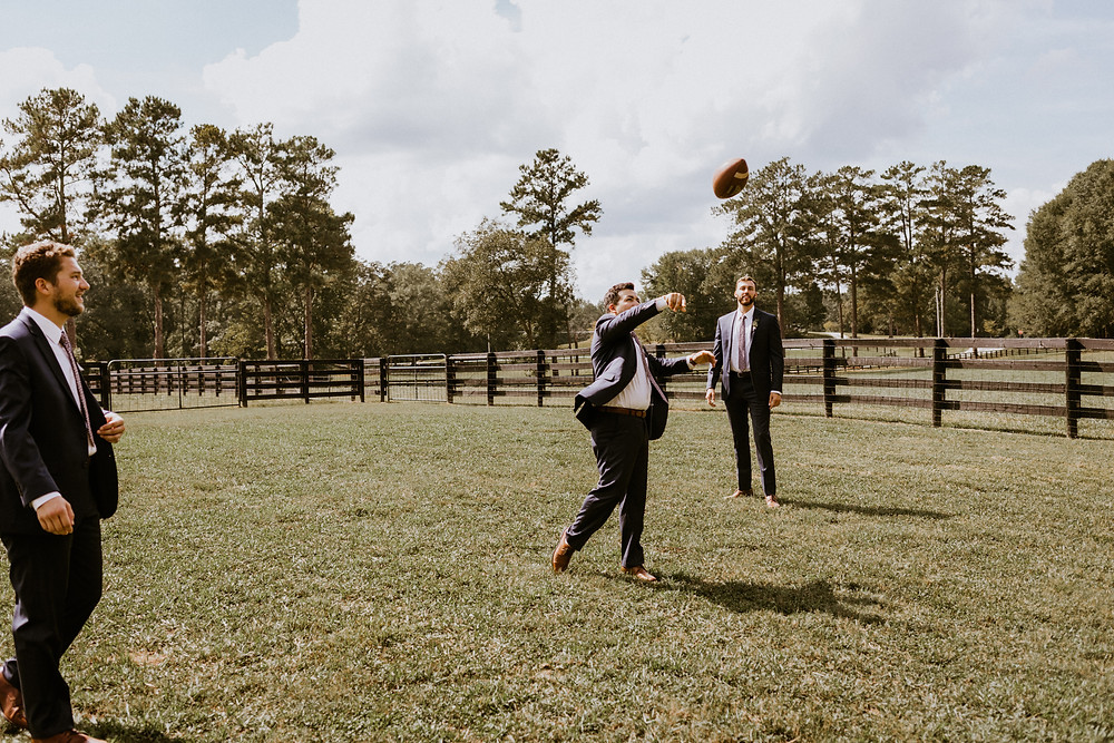 groomsmen throwing football
