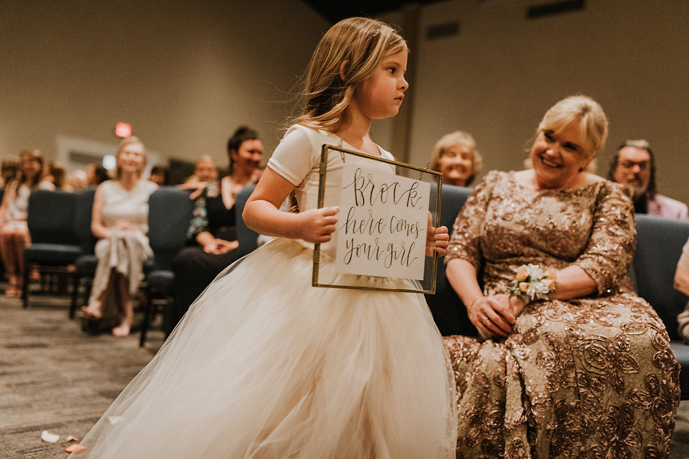 flower girl holding sign