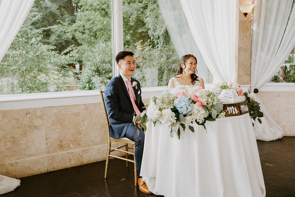 bride & groom listening to speech