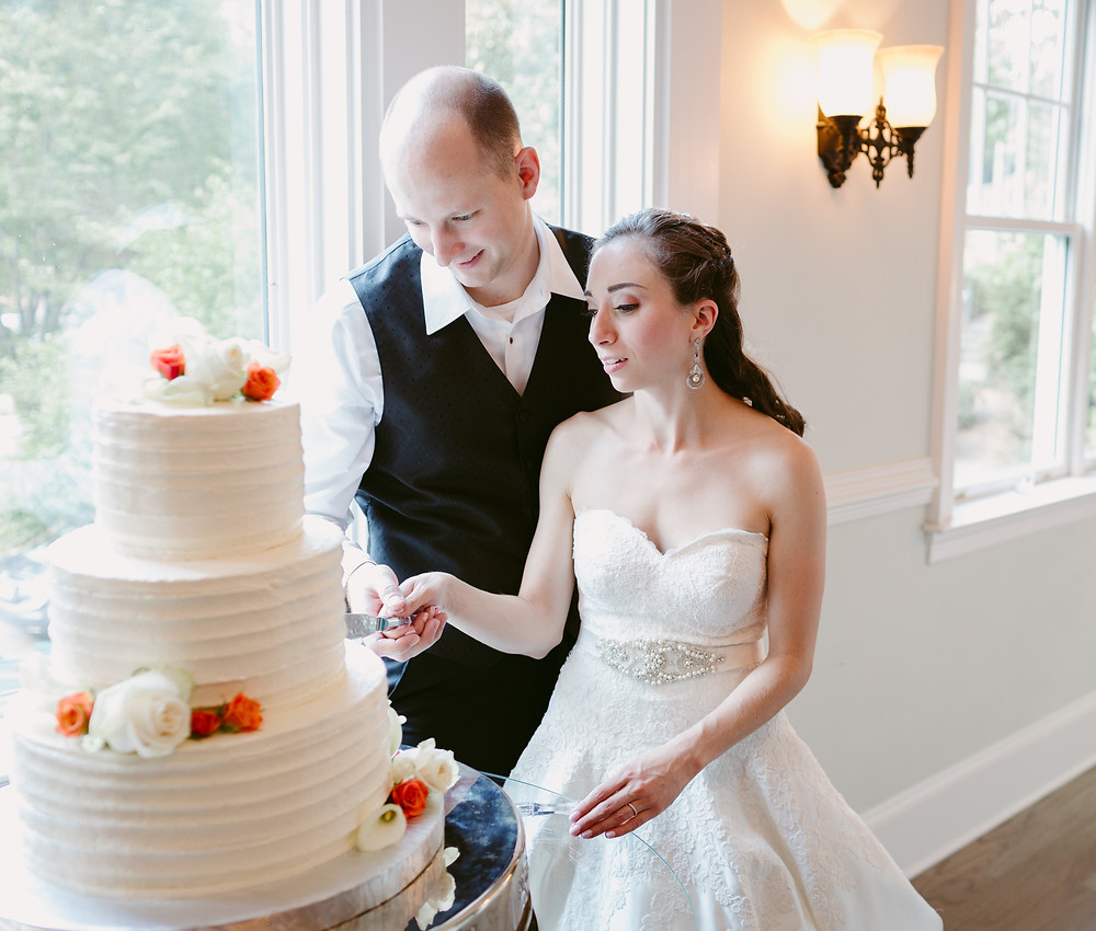 Cutting the cake by a window
