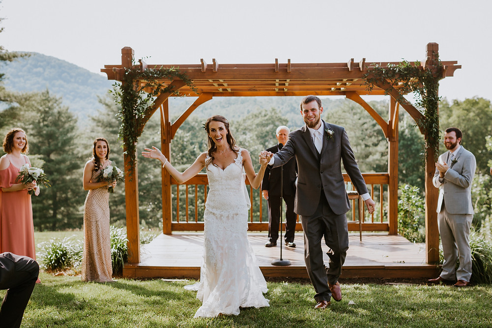 bride & groom walks down aisle