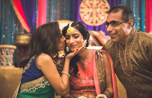 Bride and her mother during Indian Wedding ceremony known as Mehndi