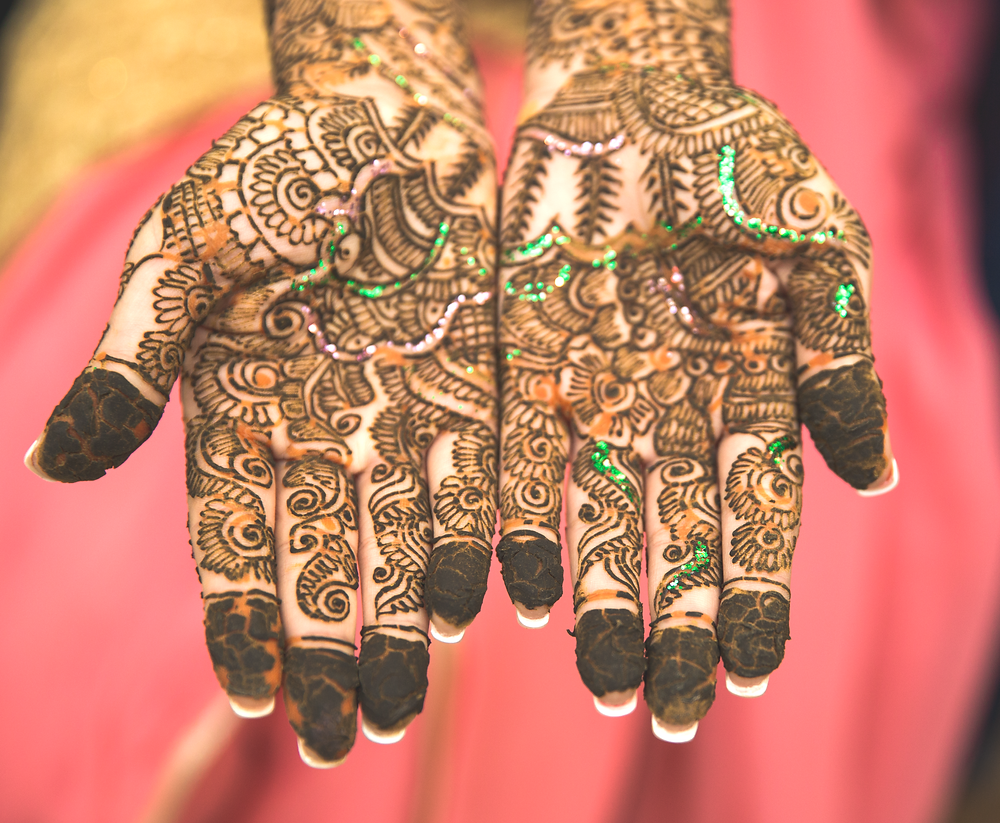 Indian Bride's henna tattoo on Mehndi night