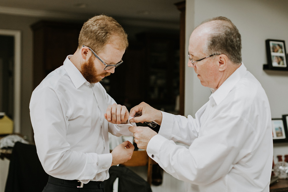 groom and dad getting ready