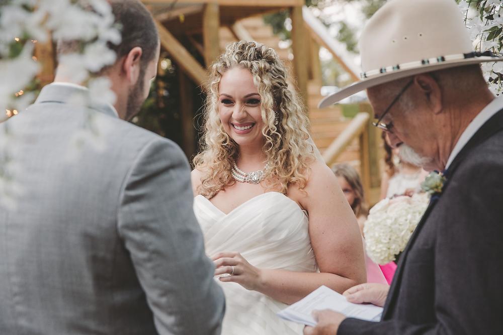 Bride smiles during wedding vows