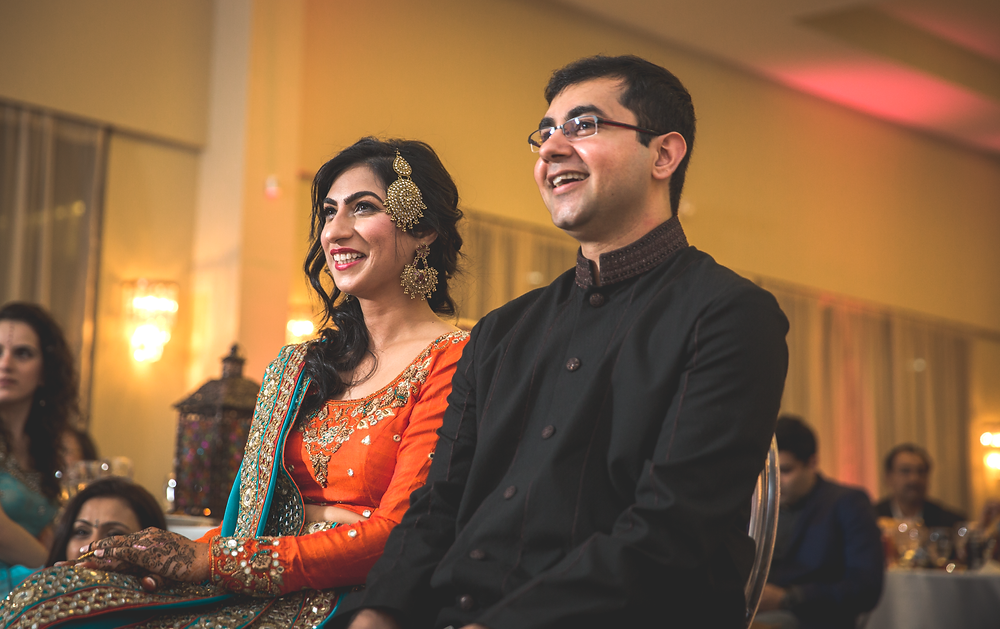 Bride and groom enjoy family performances on Mehndi night