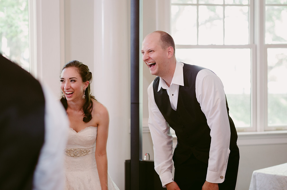 Bride and groom laughing on dance floor