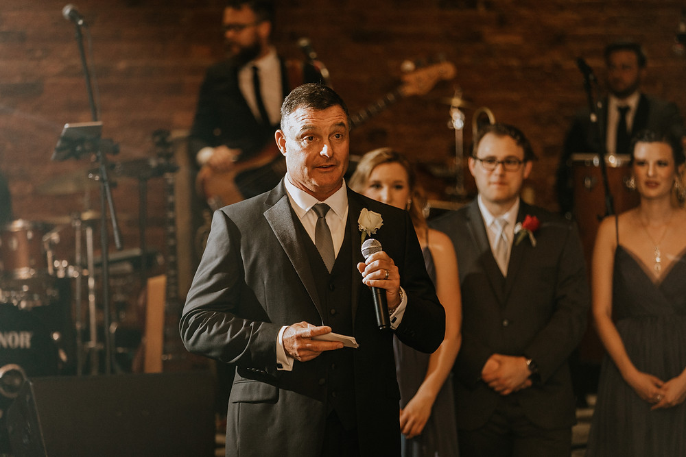 father gives speech at wedding