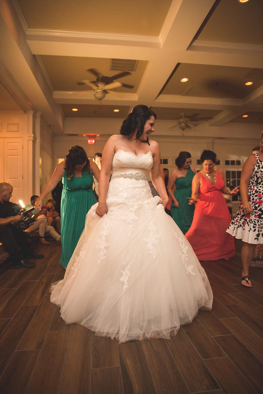 Bride funky dancing at reception
