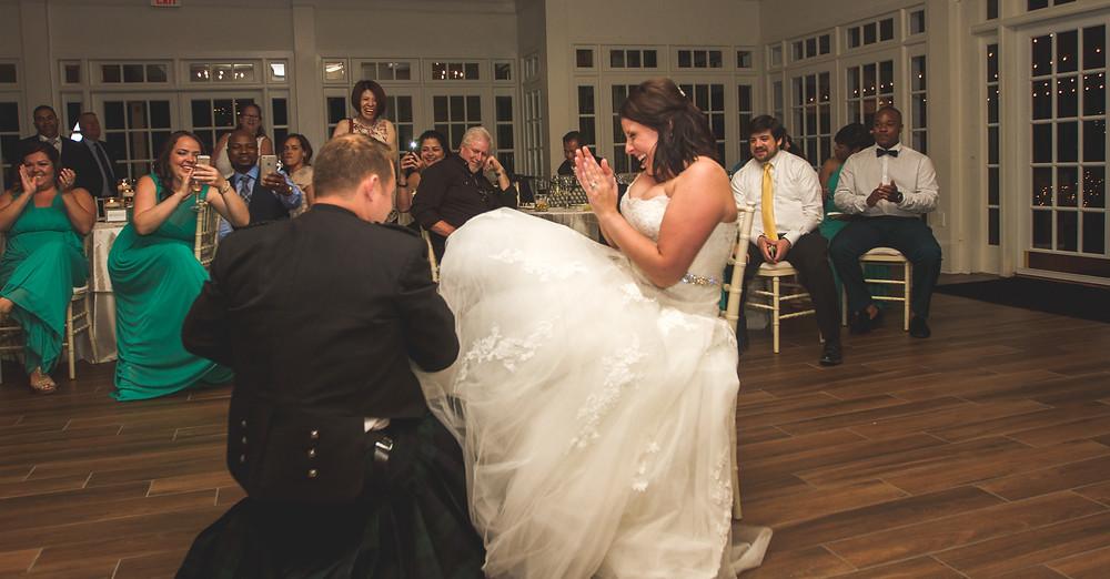 Bride laughs during garter