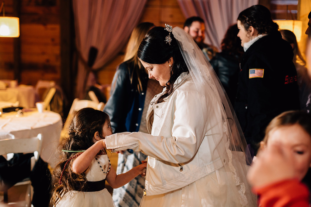 Bride dancing with flower girl