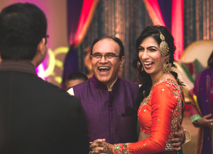 Uncle and bride laughing sangeet