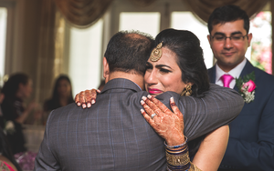She hugs her uncle at her wedding