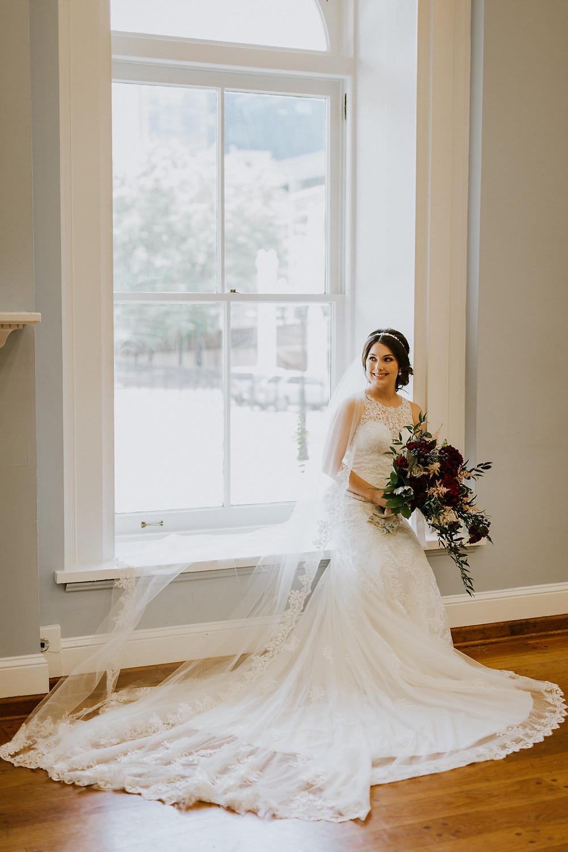 bride sits in window