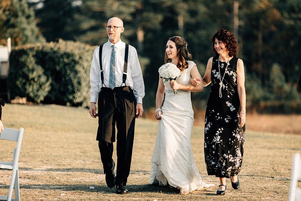 Parents walk bride down isle