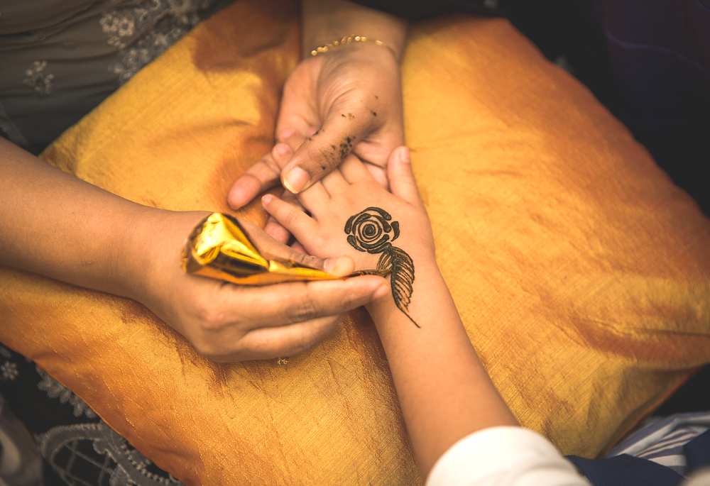 Mehndi henna art on child