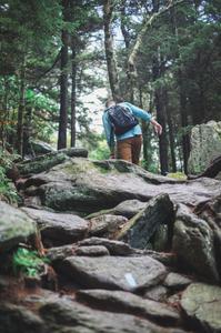 Climbing over a rock