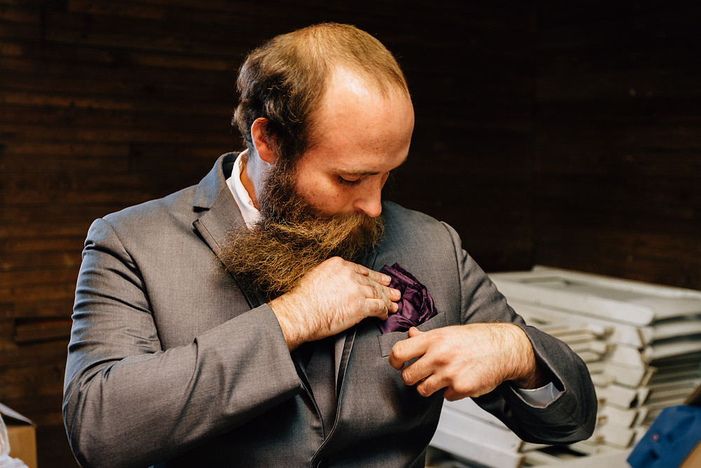 Groom with purple pocket square