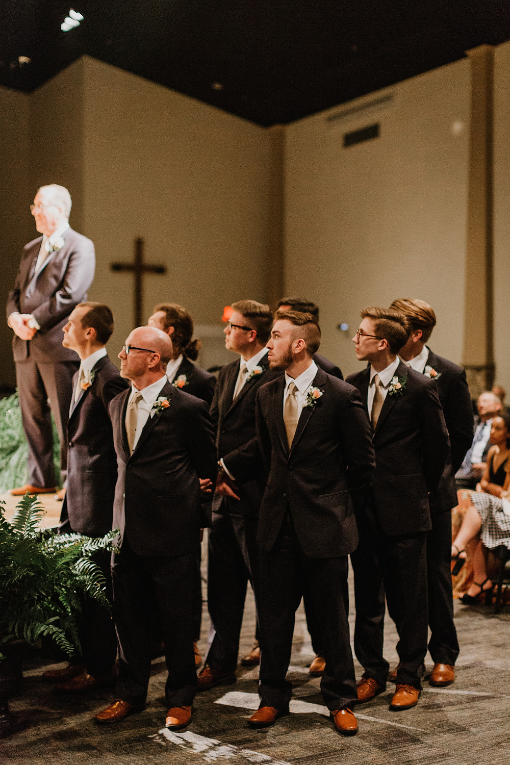 groomsmen at wedding ceremony