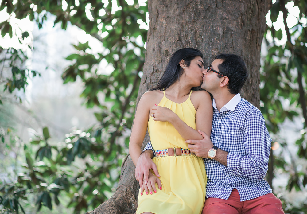 A kiss by the tree at Piedmont Park