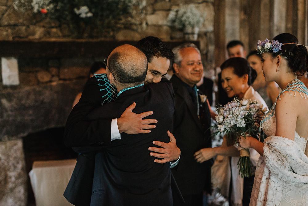 groom hugs father