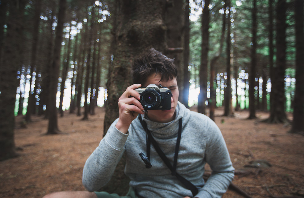 Film camera in the woods