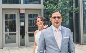 Bride taps groom on the shoulder