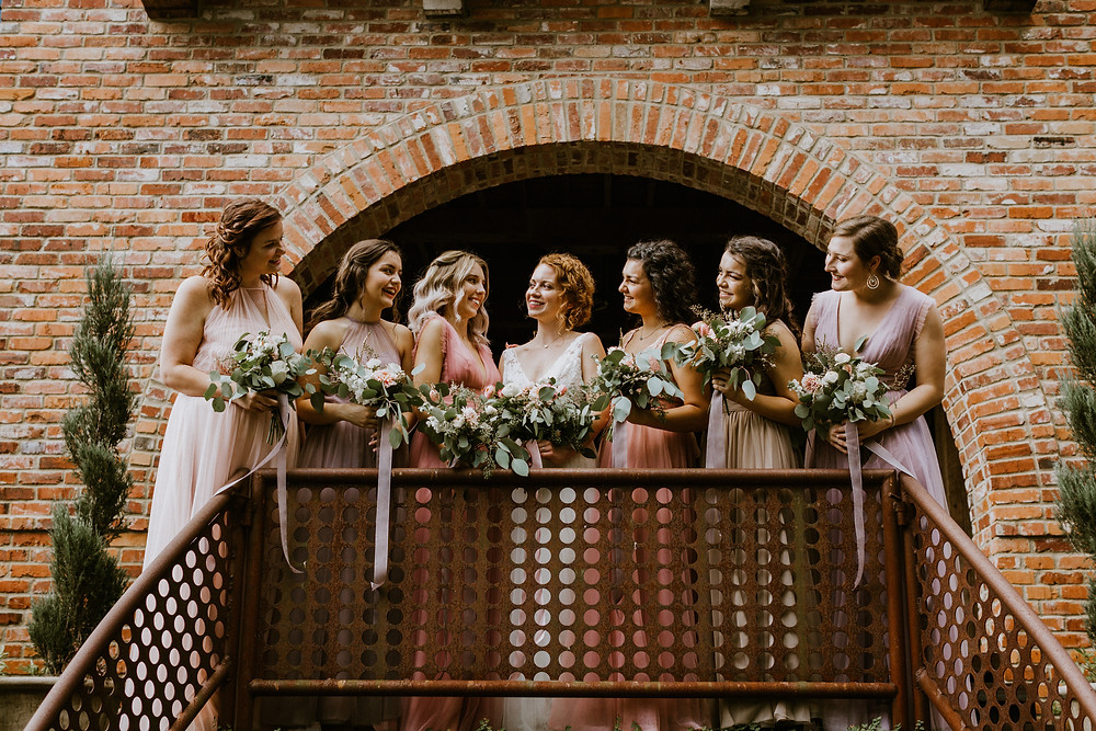 bride and bridesmaids on balcony