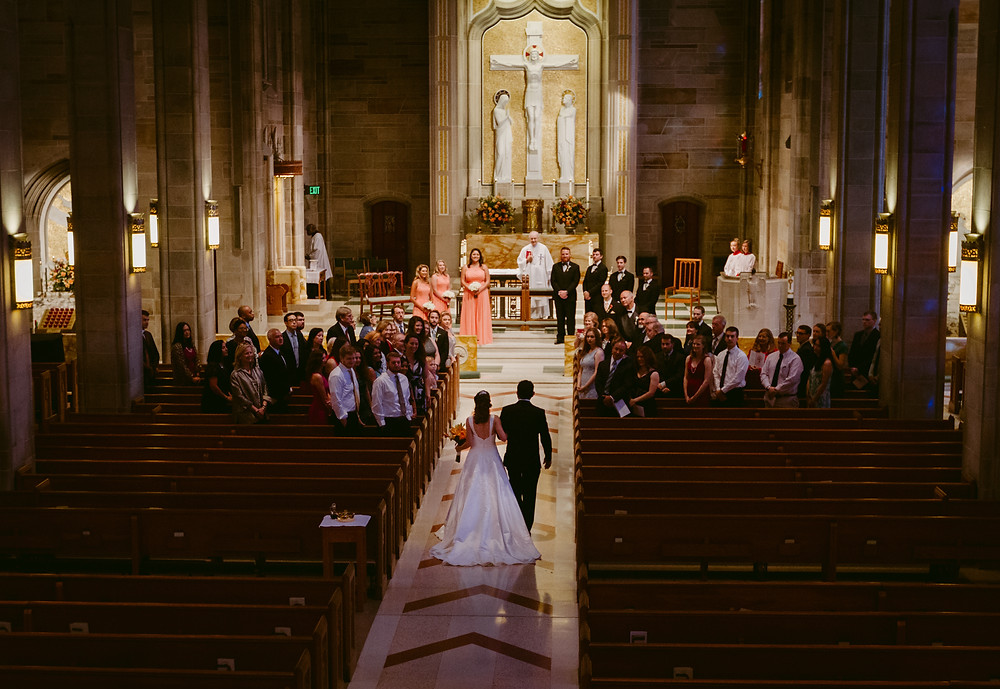 Bride walking down the aisle Cathedral of Christ the King