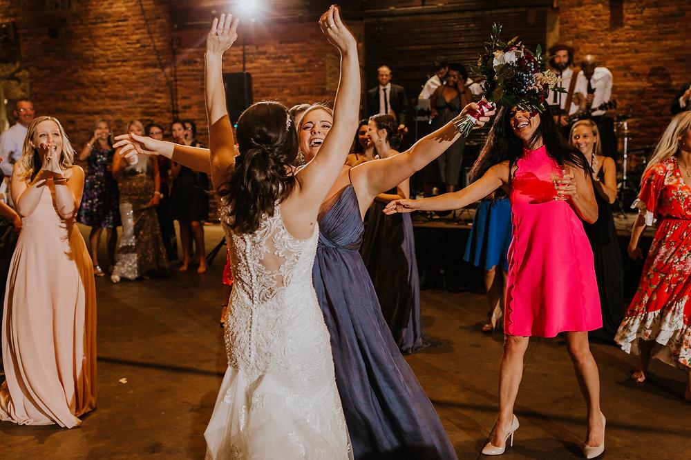maid of honor hugs bride