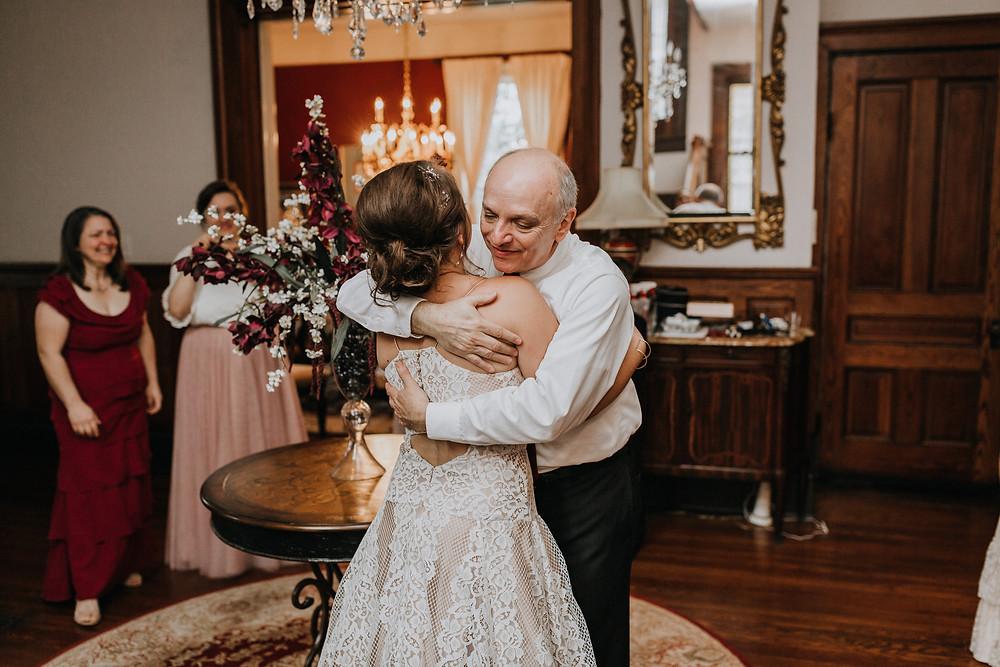Father Hugs Bride
