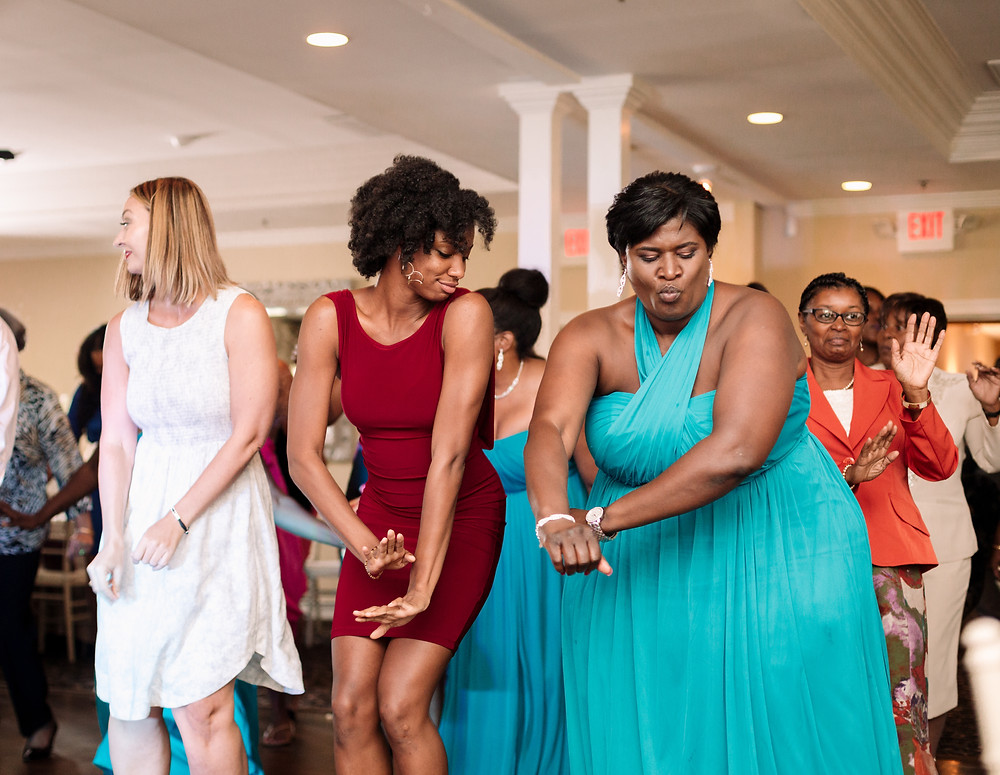 Wedding guests dancing to music
