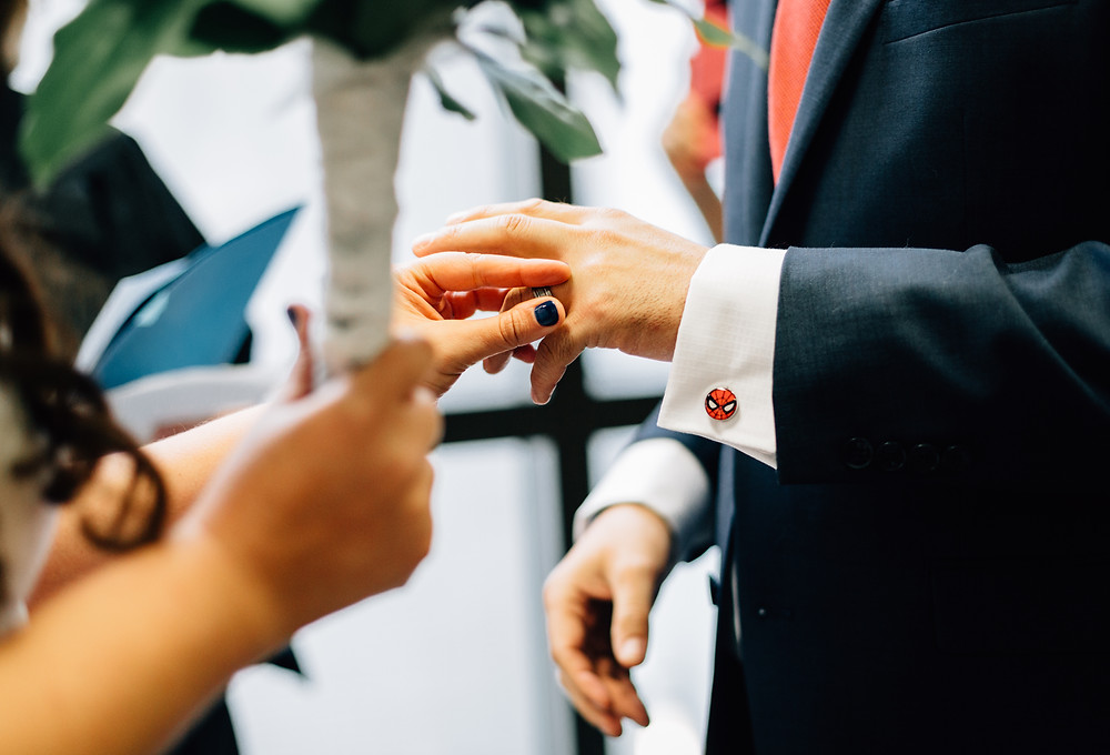 Placing ring on his finger