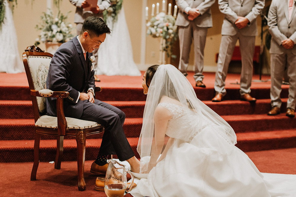 bride washes grooms feet