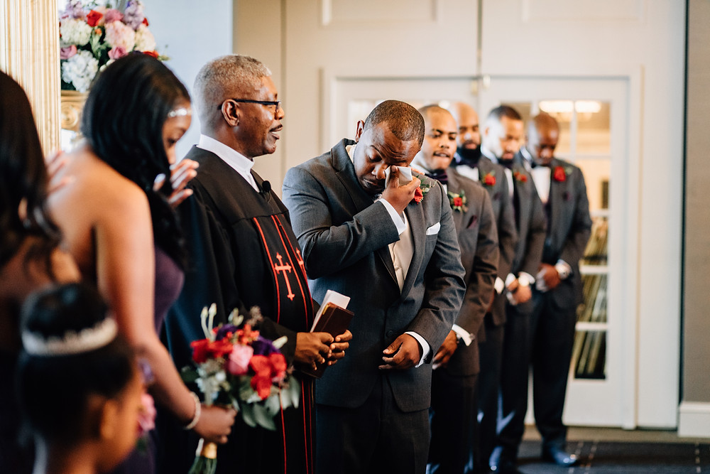 Groom cries at alter