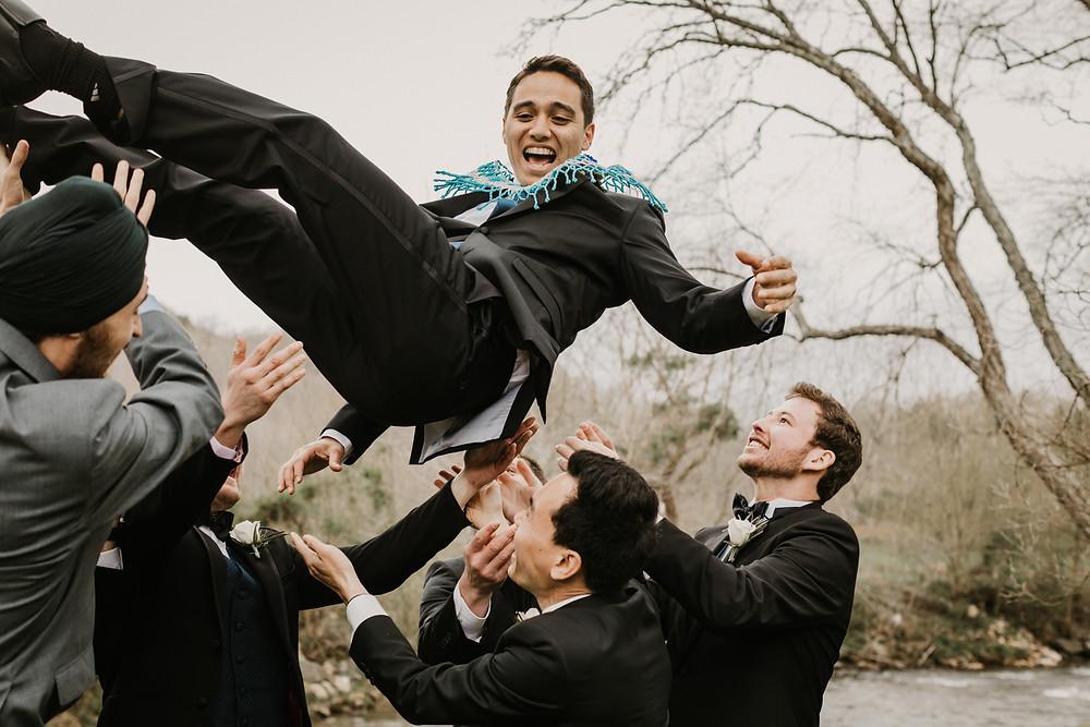 groomsmen through groom in air