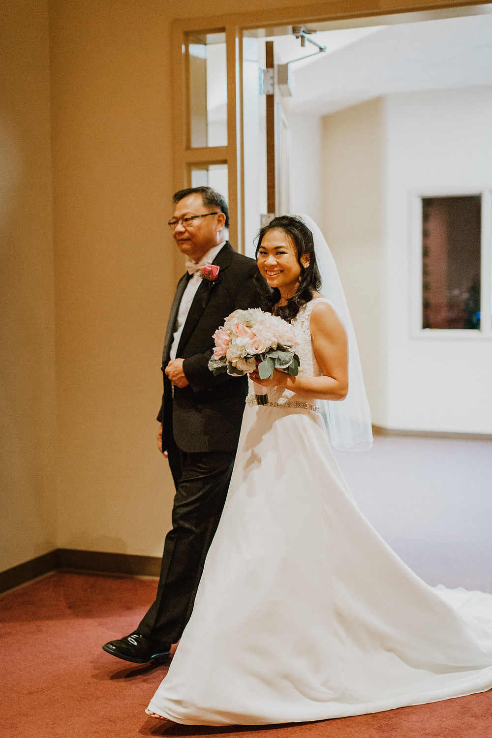 bride and father enters room