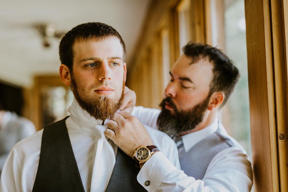groomsmen help groom