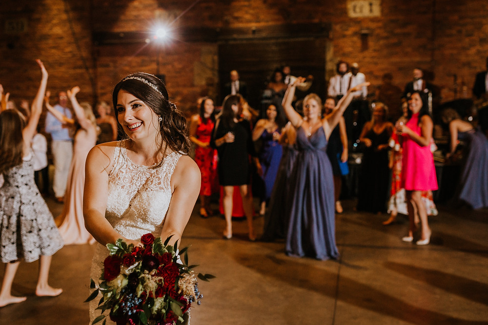 bride throws bouquet