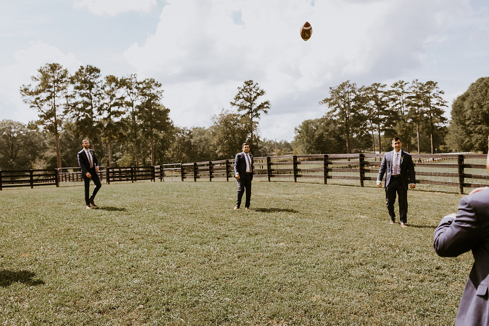 groom and groomsmen throwing football