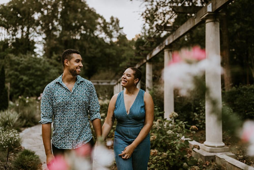 couple walking through garden